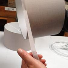Self-adhesive binding tape